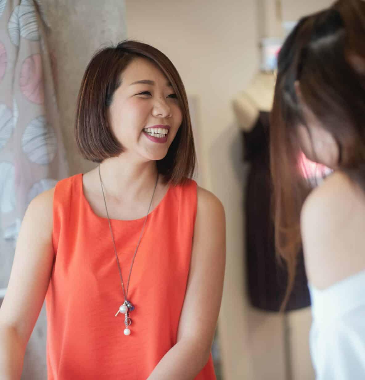 Woman smiling at customer
