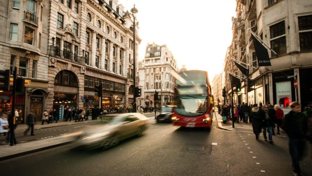 London bus driving down regent street.