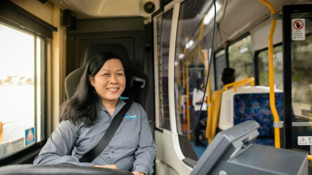 State Transit bus driver smiling at camera.