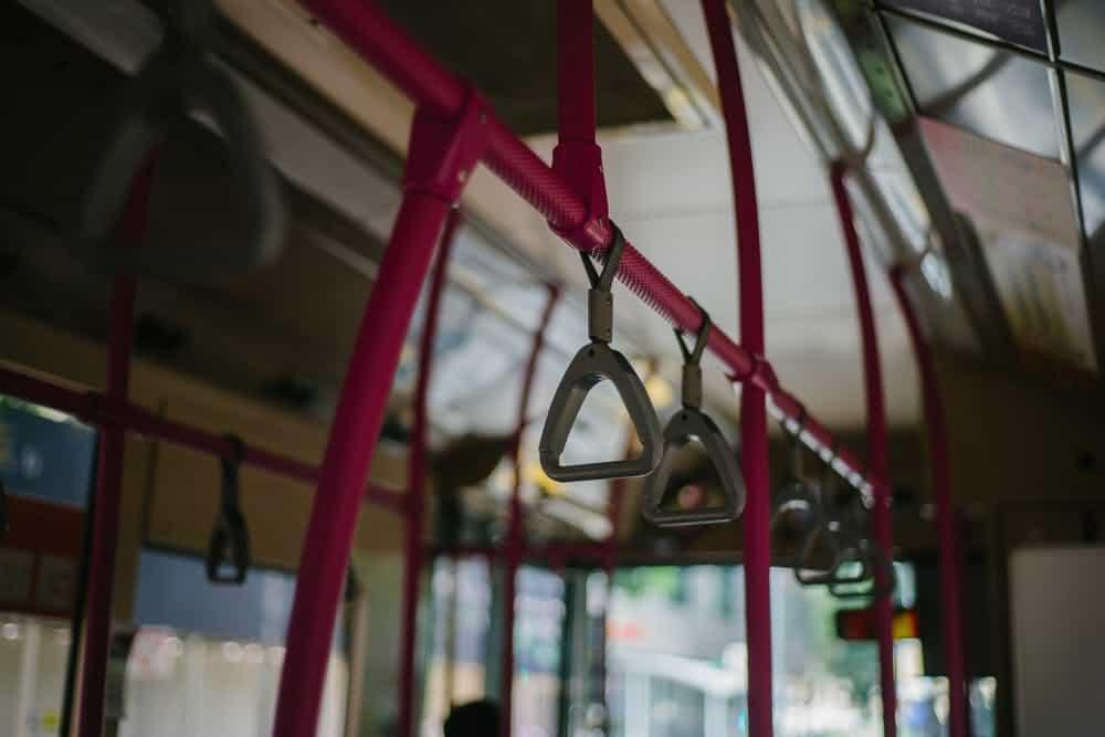 Close up of bus handles.
