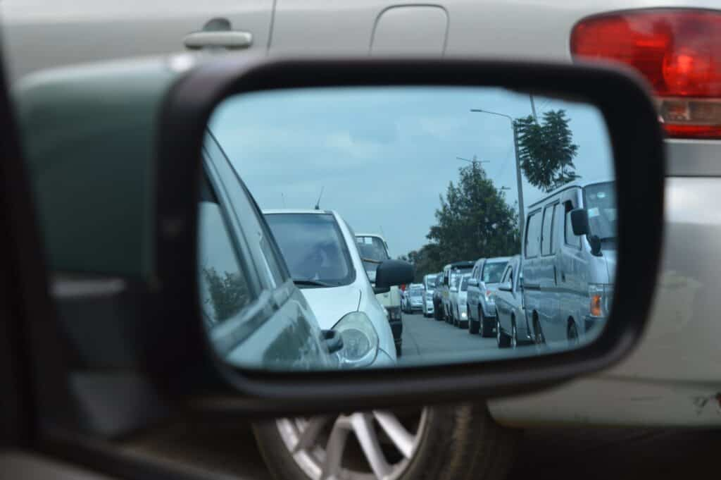 Traffic Jam reflected in car wing mirror.