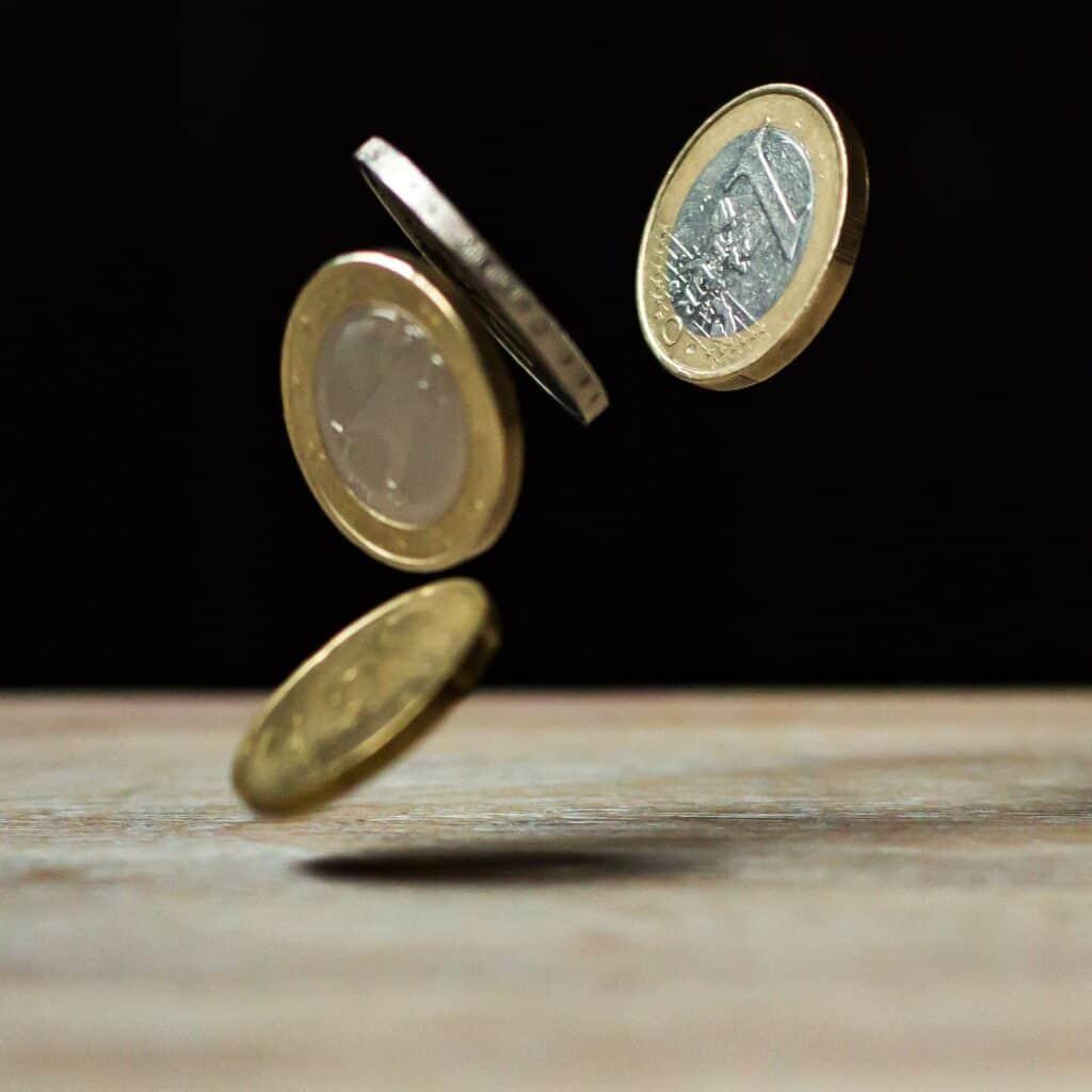 Euros falling onto table.