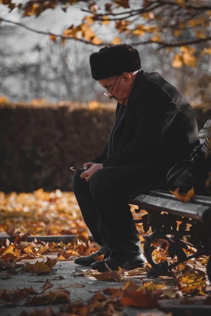 Elderly man using smartphone.