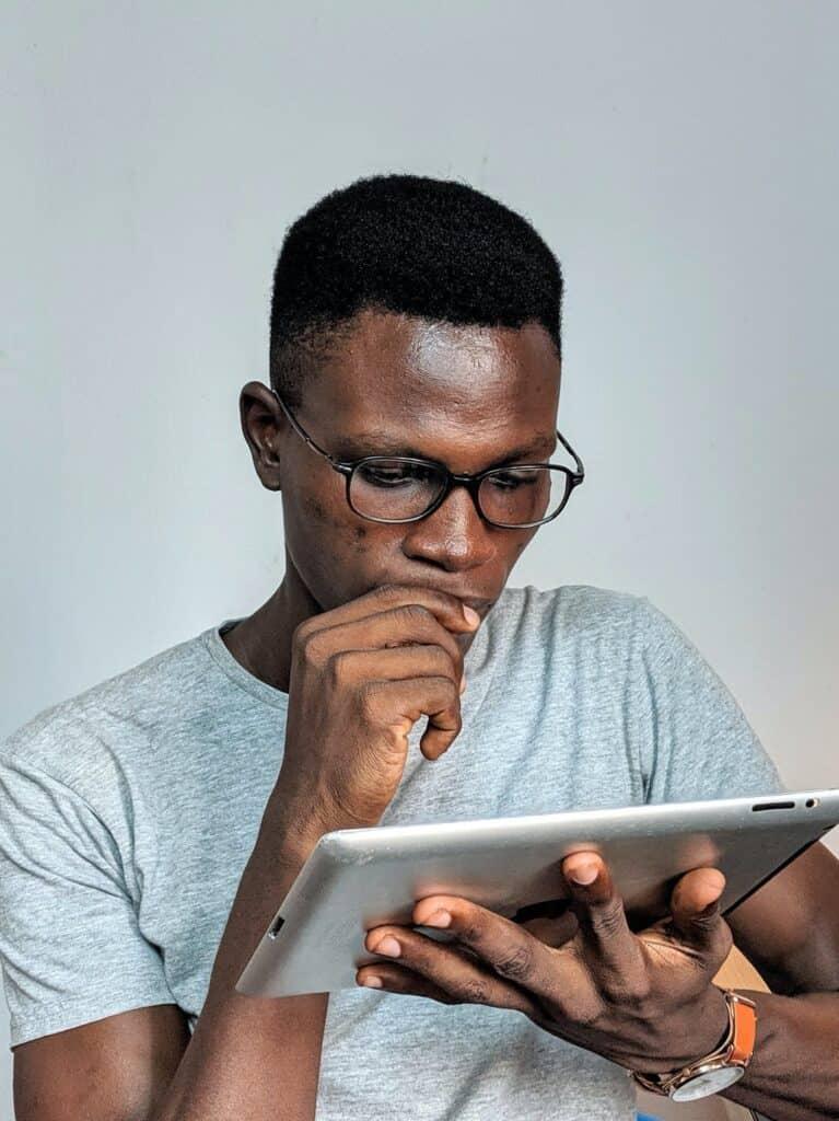 Concerned man looking at Ipad.