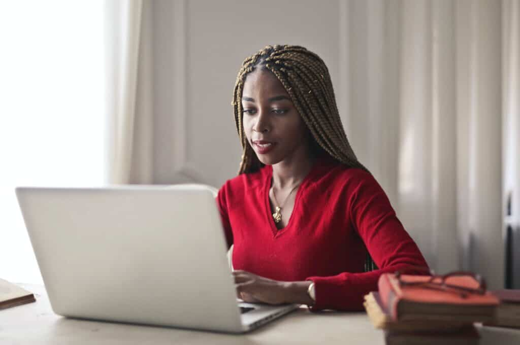 Woman using laptop.