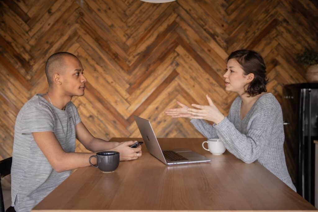 Woman explaining to man.