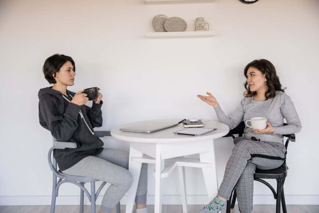 Two women having a conversation over coffee