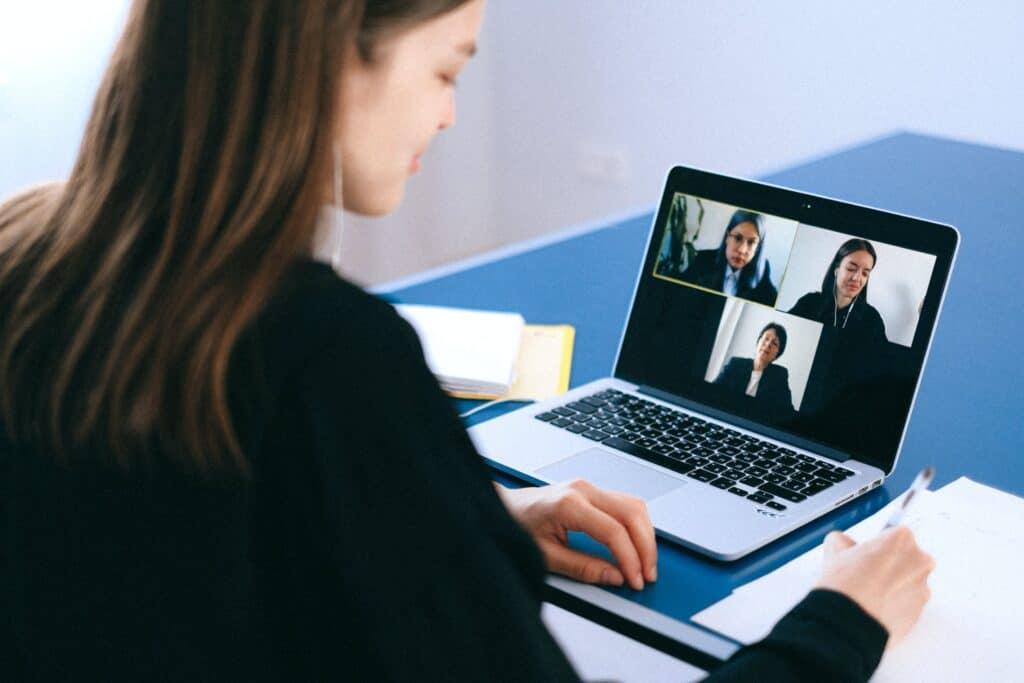 Woman hosting digital meeting.