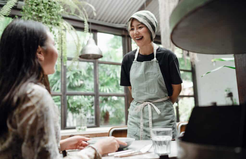 Barista smiling at customer.