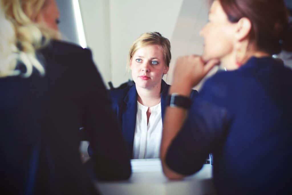 Three women having business meeting.